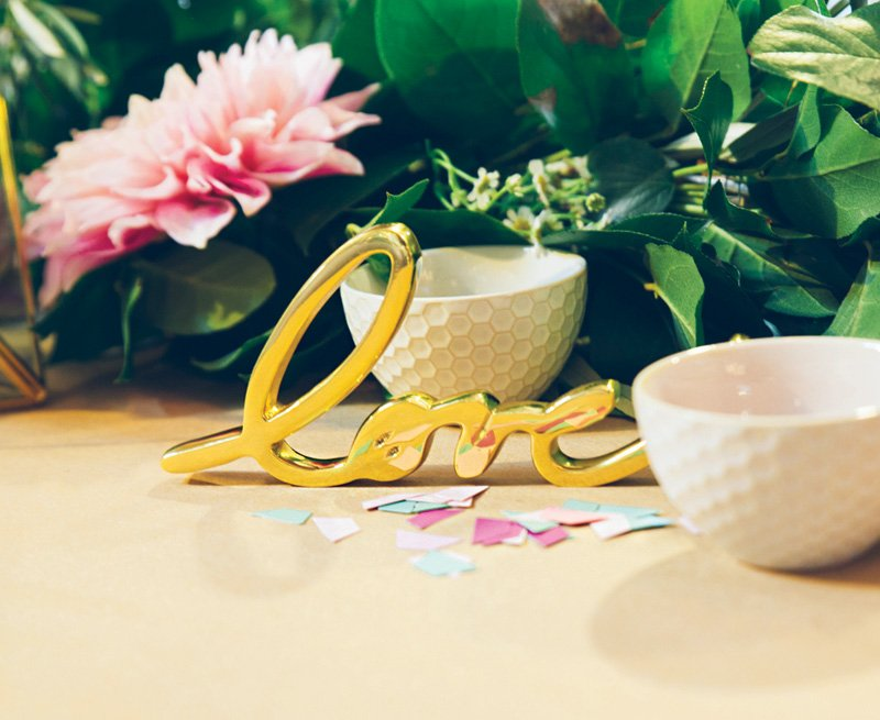 gold love figurine centerpiece