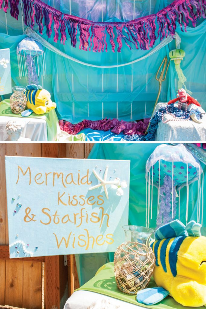 little mermaid decorated photo booth backdrop