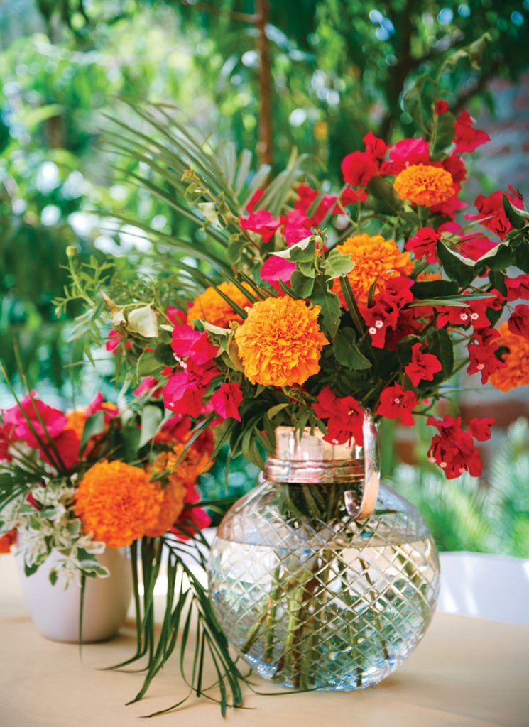Mexican fiesta floral arrangements with orange and pink flowers