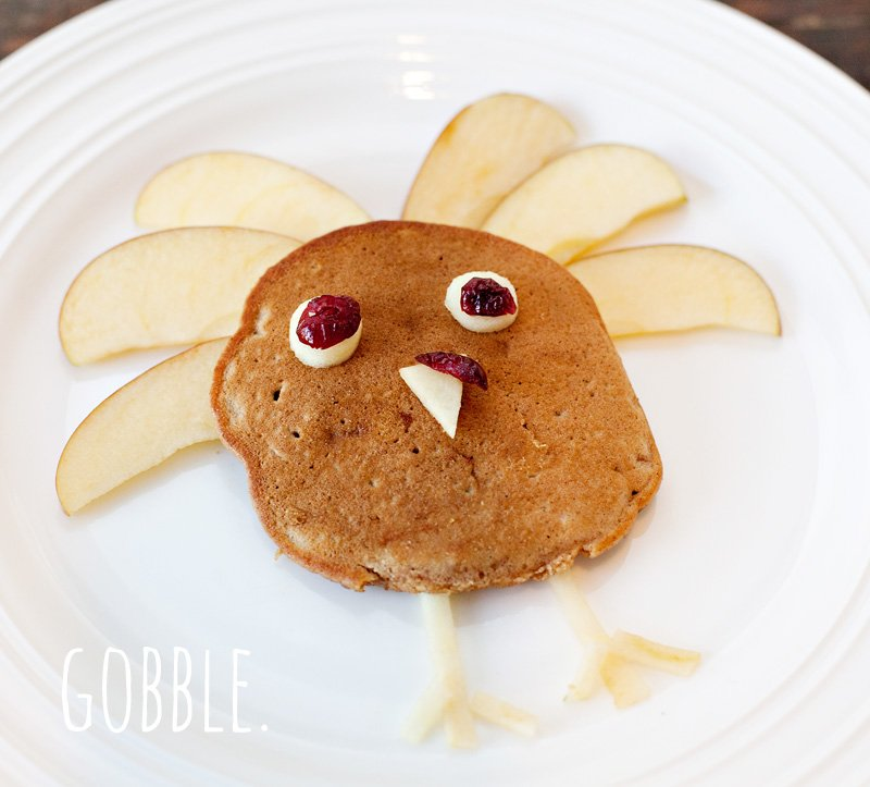 Pumpkin Apple Pancakes shaped like a turkey