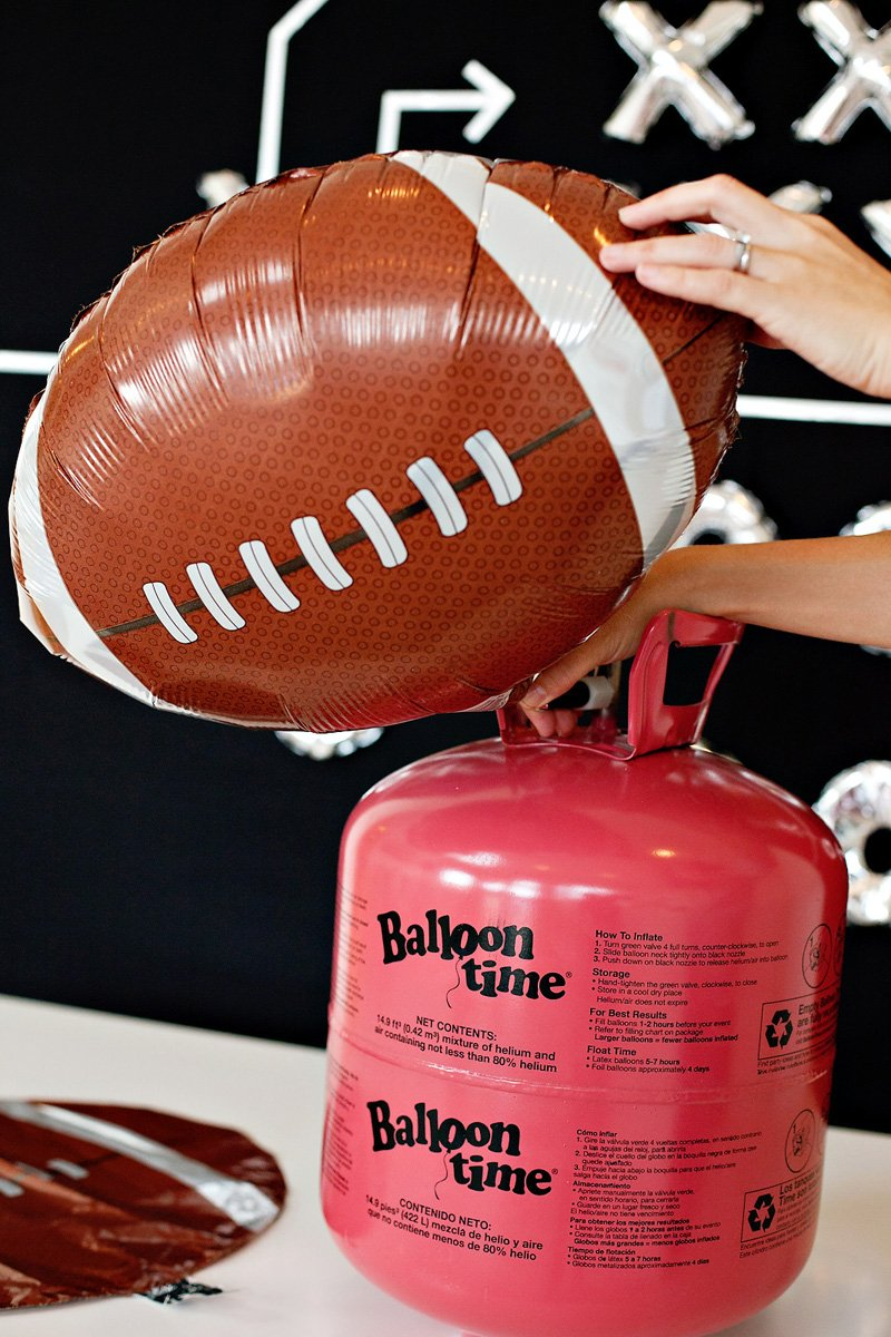 "Balloon Time tank and 18"" mylar football balloons"