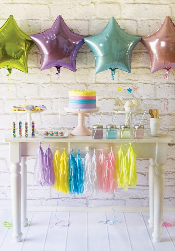 pastel rainbow birthday party dessert table