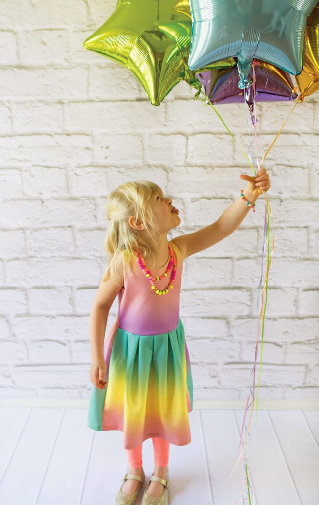 rainbow star balloons and rainbow party dress