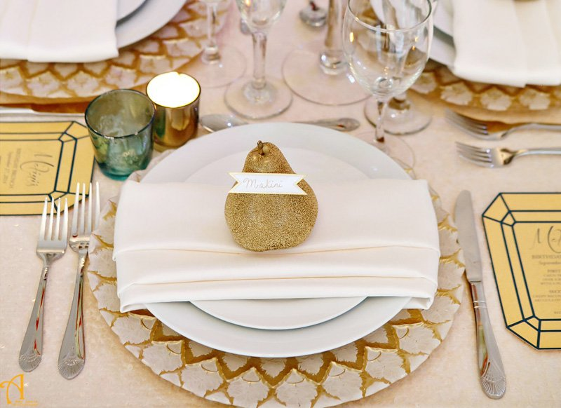 gold white place setting with pear place card