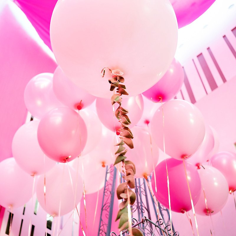 giant pink balloon with felt leaf garland