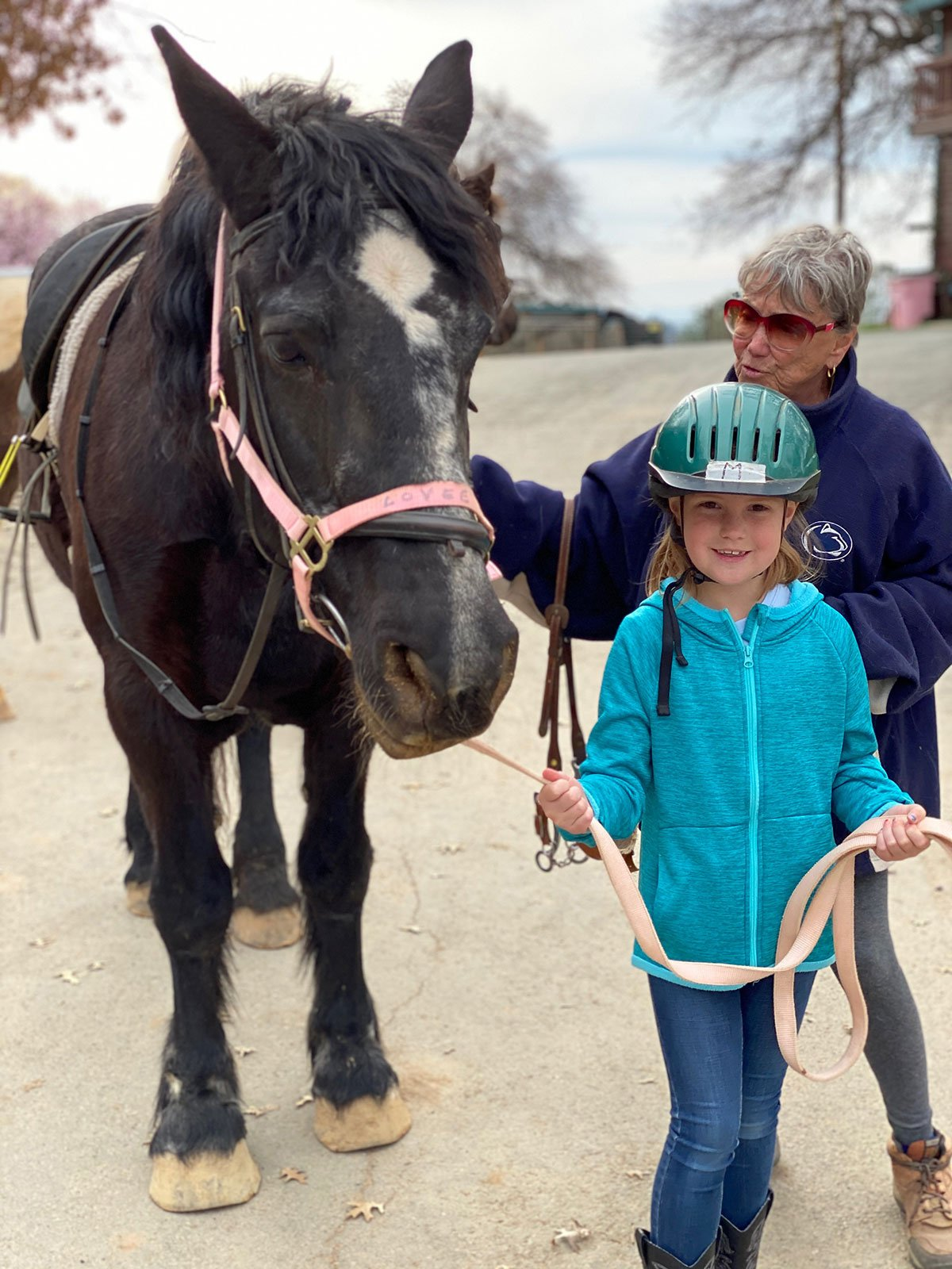 young girl walking a pony